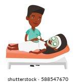 cosmetologist applying mask on... | Shutterstock .eps vector #588547670