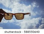 sunglasses with blue sky  | Shutterstock . vector #588550640