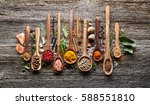 spices and herbs on a wooden... | Shutterstock . vector #588551810