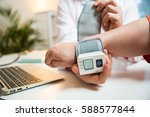 doctor measuring blood pressure ...   Shutterstock . vector #588577844