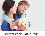 portrait of happy mother and...   Shutterstock . vector #588629318