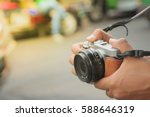 Tourist hold digital camera (mirrorless camera) ready for take a photo