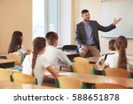 pupils listening teacher in... | Shutterstock . vector #588651878
