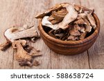 dried mushrooms  on a wooden... | Shutterstock . vector #588658724