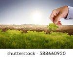 businessman hand assemble...   Shutterstock . vector #588660920