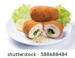 chicken kiev cutlet with green... | Shutterstock . vector #588688484