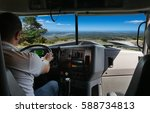 the truck driver on the road... | Shutterstock . vector #588734813