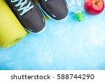 yoga mat  sport shoes  apples ... | Shutterstock . vector #588744290