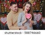 guy hug girl from behind. woman ...   Shutterstock . vector #588746660