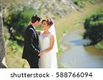 bride gently looking at groom... | Shutterstock . vector #588766094