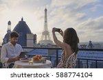 romantic couple using... | Shutterstock . vector #588774104