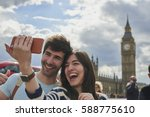 Tourist Couple Taking Selfies...