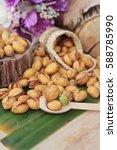 pistachio nuts at salt baked is ... | Shutterstock . vector #588785990