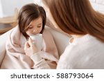 pleasant loving mother helping... | Shutterstock . vector #588793064