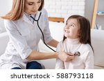 pleasant female doctor... | Shutterstock . vector #588793118