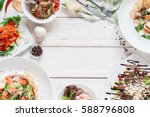 warm salads frame on white wood ... | Shutterstock . vector #588796808