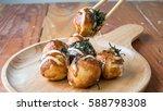 candy takoyaki in wooden bowls   Shutterstock . vector #588798308