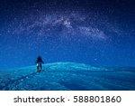 a climber climbs up a snowy... | Shutterstock . vector #588801860