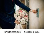 the groom with a bouquet   Shutterstock . vector #588811133
