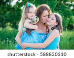 portrait of mother and two... | Shutterstock . vector #588820310