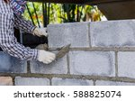 Bricklayer Putting Down Anothe...