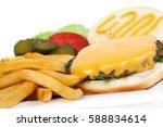 open cheeseburger burger closeup | Shutterstock . vector #588834614