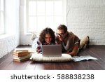 young happy family relaxing at... | Shutterstock . vector #588838238