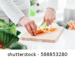 woman cooking healthy food in... | Shutterstock . vector #588853280