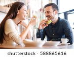 happy loving couple enjoying... | Shutterstock . vector #588865616