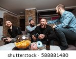 a company of four men having... | Shutterstock . vector #588881480