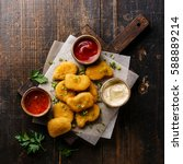 chicken breast nuggets with... | Shutterstock . vector #588889214