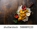 chicken breast nuggets with... | Shutterstock . vector #588889220