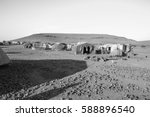 refugee camp near the village... | Shutterstock . vector #588896540