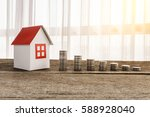 stacking coins and home model... | Shutterstock . vector #588928040