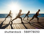 silhouettes of sportive girls... | Shutterstock . vector #588978050