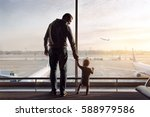father and son standing in the... | Shutterstock . vector #588979586