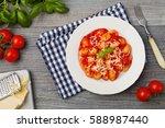 portion of gnocchi in tomato...   Shutterstock . vector #588987440