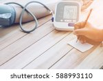 doctor cardiologist measuring... | Shutterstock . vector #588993110