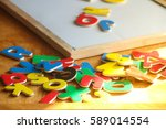 kid is learning the alphabets... | Shutterstock . vector #589014554