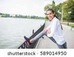 healthy athlete girl stretching ... | Shutterstock . vector #589014950
