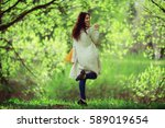 cheerful and happy young girl... | Shutterstock . vector #589019654