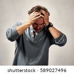 depressed man having a headache ... | Shutterstock . vector #589027496