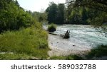 Rough River With Uprooted Tree...