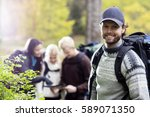 young male hiker with friends... | Shutterstock . vector #589071350