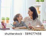 happy family. mother and... | Shutterstock . vector #589077458