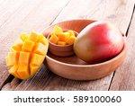 mango sliced in wooden plate   Shutterstock . vector #589100060