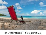 old red beach chair on sandy... | Shutterstock . vector #589154528