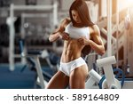 fitness woman showing abdominal ... | Shutterstock . vector #589164809