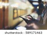 enjoying travel. young woman... | Shutterstock . vector #589171463