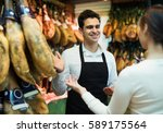 brunette choosing iberico and... | Shutterstock . vector #589175564
